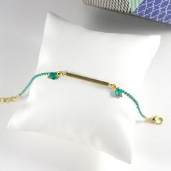 Bracelet vert et doré perles à facettes
